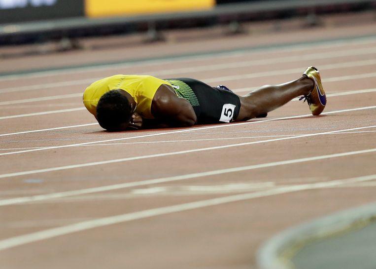 Usain Bolt raakte bij de WK als slotloper op de 4x100 meter geblesseerd aan zijn bovenbeen en kon niet meer verder. Beeld AP
