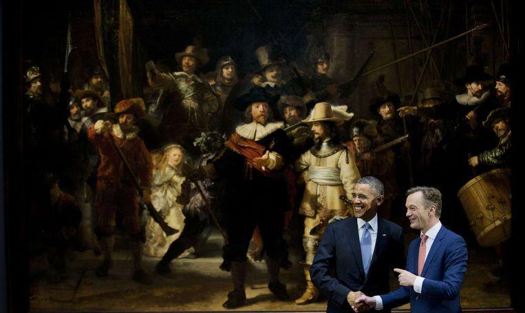Pijbes schudt onverwachts de hand van president Obama. Beeld anp