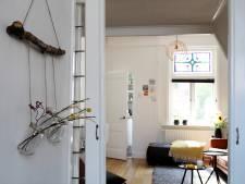 Recycle je glazen potjes en gebruik ze als wanddecoratie