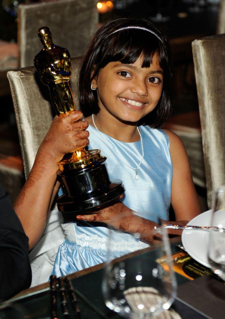 Eén van de vele Oscars die Slumdog Millionaire mee naar huis mocht nemen. Beeld UNKNOWN