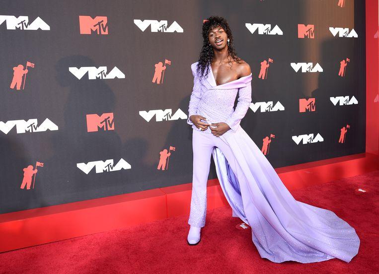 Lil Nas X in zijn paarse broekjurk.  Beeld Evan Agostini/ Invision/AP