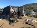 De afgebrande ravage van kamp Moria.