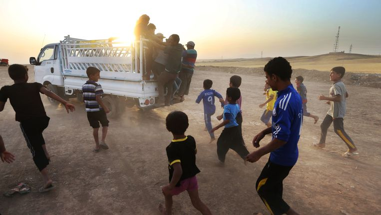 Iraakse vluchtelingen in de noordelijke stad Irbil. Beeld ap