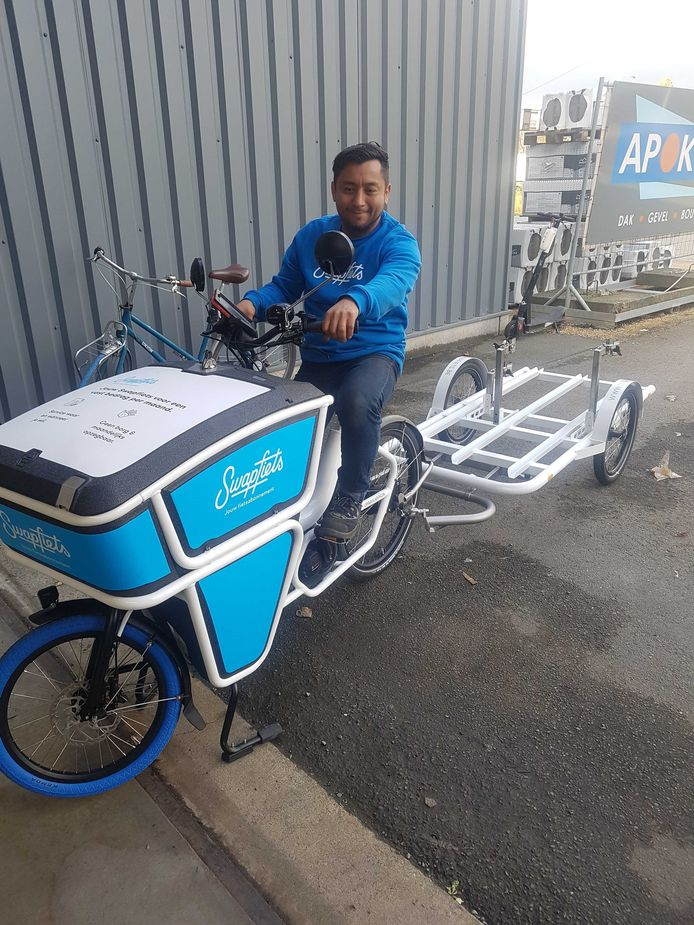 'Swapfiets-fiets': een elektrische bezorgfiets met aanhangwagentje met plaats voor drie Swapfietsen. Die zal ingezet worden om nieuwe fietsen te leveren, kapotte fietsen op te halen en reparaties uit te voeren.