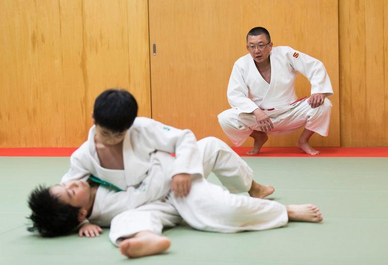 In Japan zijn er sinds 1983 121 kinderen overleden door judotrainingen: er braken nekken tijdens het uitdelen van straffen, er volgden zelfdodingen na de jarenlange vernederingen.  Beeld AP