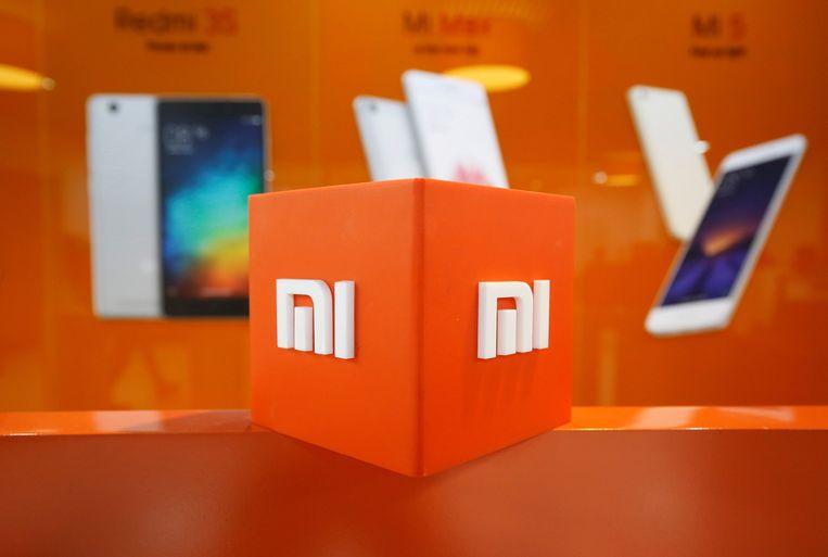 Het logo van Xiaomi in een kantoor in Bengaluru, India.  Beeld Reuters