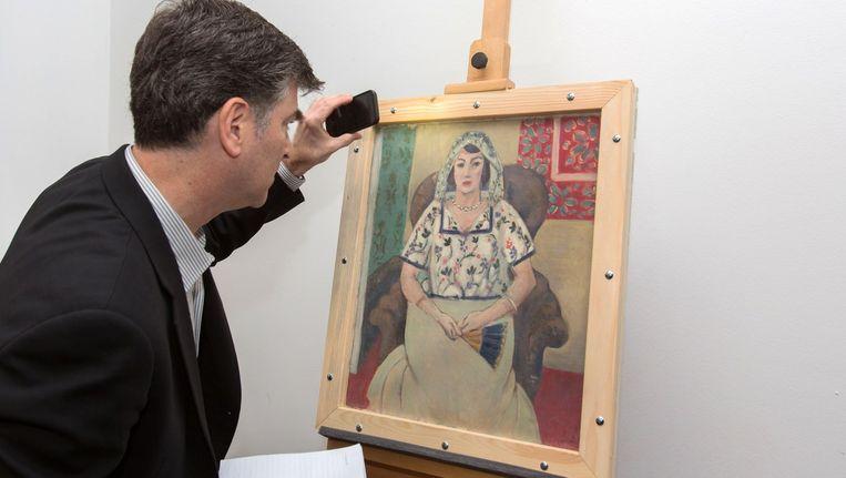 Het doek Femme Assise (Zittende vrouw). Beeld afp