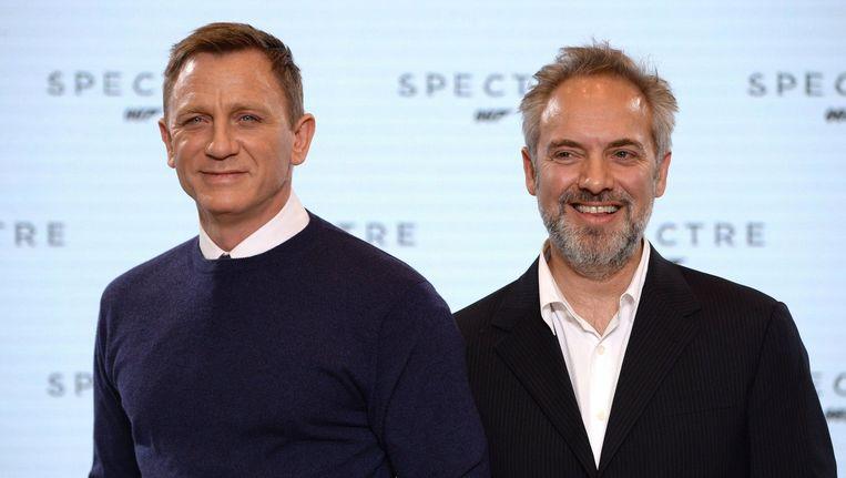 Daniel Craig en regisseur Sam Mendes tijdens de voorstelling van de nieuwe Bond-film. Beeld PHOTO_NEWS