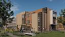 De voorkant van het gebouw vanaf de rechterkant. Opvallend is het grote glazen raam rechts aan de kant van de Elsboerlaan. Dat moet de transparantie moet vergroten.