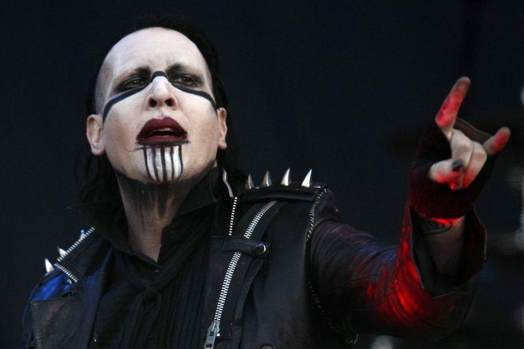 Marilyn Manson, hier tijdens een optreden in Chili in 2012, wordt door verschillende vrouwen beschuldigd van intimidatie, misbruik en seksueel geweld. Beeld EPA