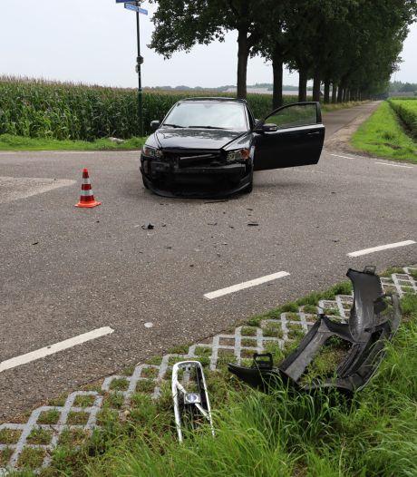 Schade aan auto's door frontale botsing in Boekel