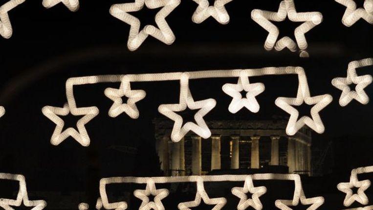 Het Parthenon gaat schuil achter kerstverlichting Beeld afp
