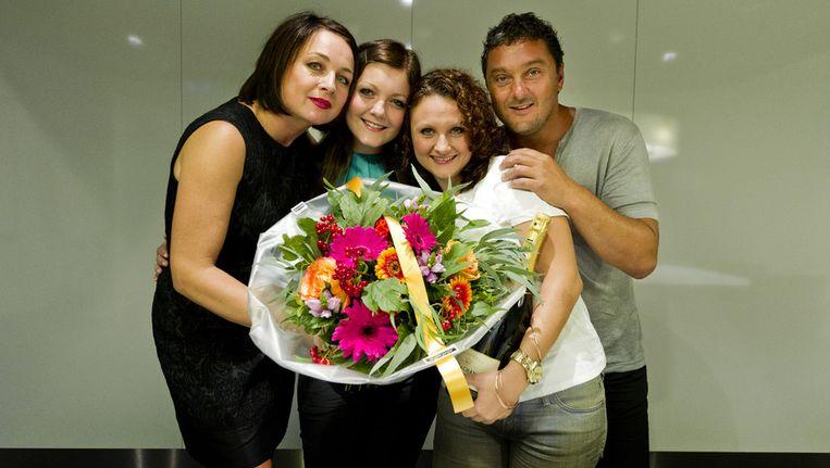 Mandy Pijnenburg (in wit shirt) met haar familie. © ANP Beeld
