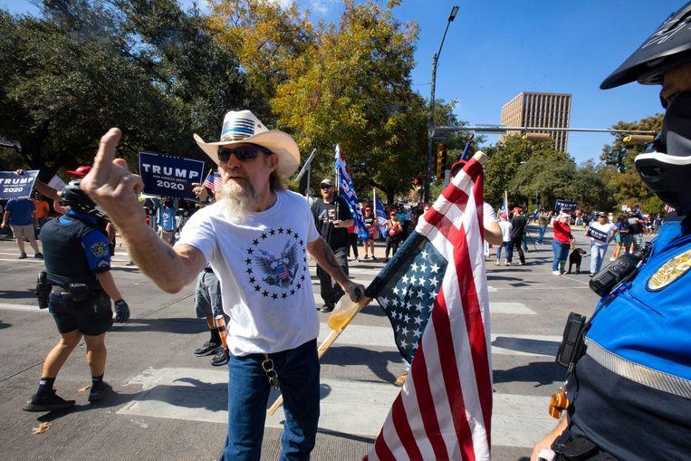 Trump-supporters op straat in Austin, Texas.  Beeld Photo News