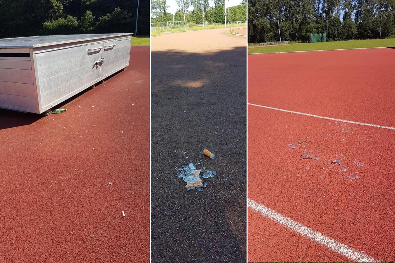 De onbekenden lieten gebroken flessen en glazen achter op de atletiekpiste.