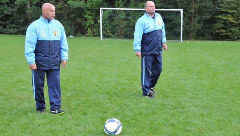 Don Guezen (links) traint niet langer het eerste elftal van DWV. Foto John Beckman Beeld