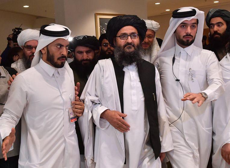 Mullah Abdul Ghani Baradar in februari in Qatar, na besprekingen met de Verenigde Staten. Over de Taliban-leider doen allerlei geruchten de ronde sinds zijn afwezigheid zondag bij de ontvangst van de Qatarese minister van Buitenlandse Zaken, met wie Baradar een goede band heeft. Beeld AFP