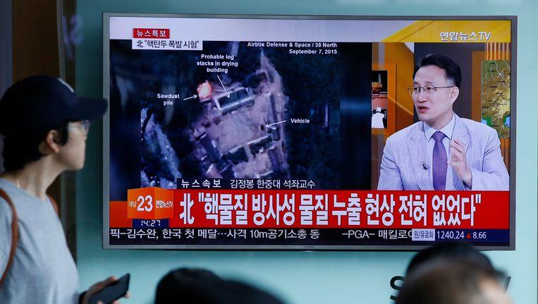 Berichtgeving op de Zuid-Koreaanse televisie over de kernproef in Noord-Korea. Beeld EPA