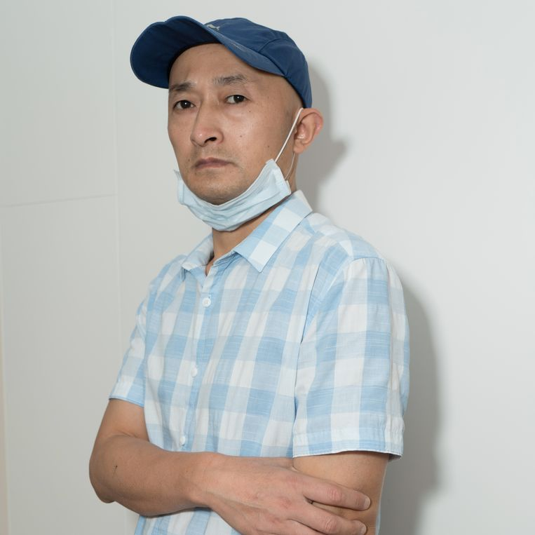 De Chinezen werden volgens Zhang Hai veel te laat geïnformeerd over het Covid-19-virus: 'Ik had mijn vader niet naar Wuhan moeten brengen. Ik heb het gevoel dat ik hem de dood heb ingejaagd.'  Beeld Ruben Lundgren