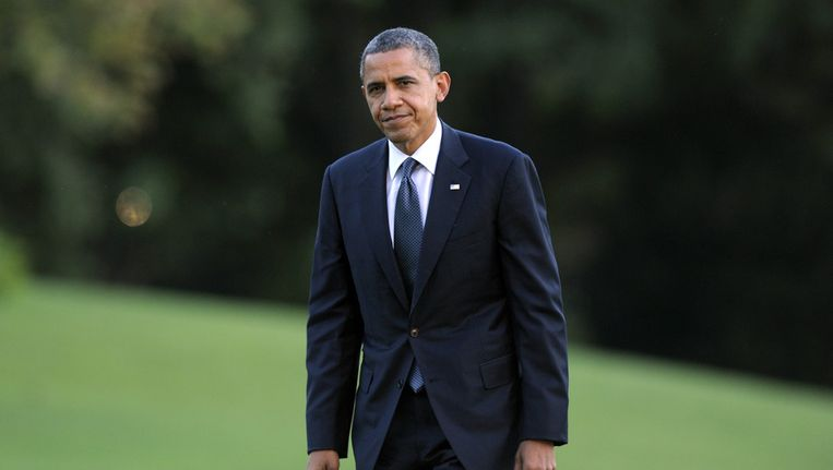 President Barack Obama in de tuin van het Witte Huis, gisteren. Beeld ap