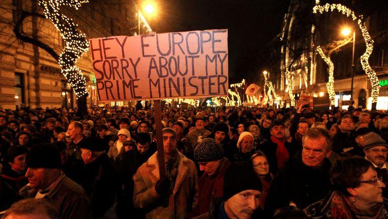 Een anti-regeringsdemonstratie in de Hongaarse hoofdstad Boedapest. Beeld REUTERS