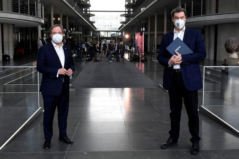 Armin Laschet (links) en Markus Söder (rechts) vlak na hun persconferentie in Berlijn. Beeld REUTERS