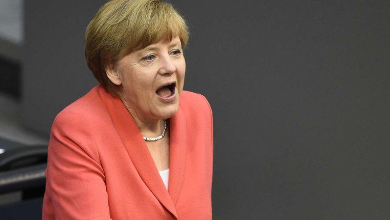 Angela Merkel wordt gefeliciteerd voor haar 61e verjaardag. Beeld AFP