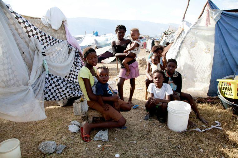 Slachtoffers van de aardbeving in Haïti in 2010 in opvangkamp Pont-Rouge bij Port-au-Prince. Beeld Hollandse Hoogte