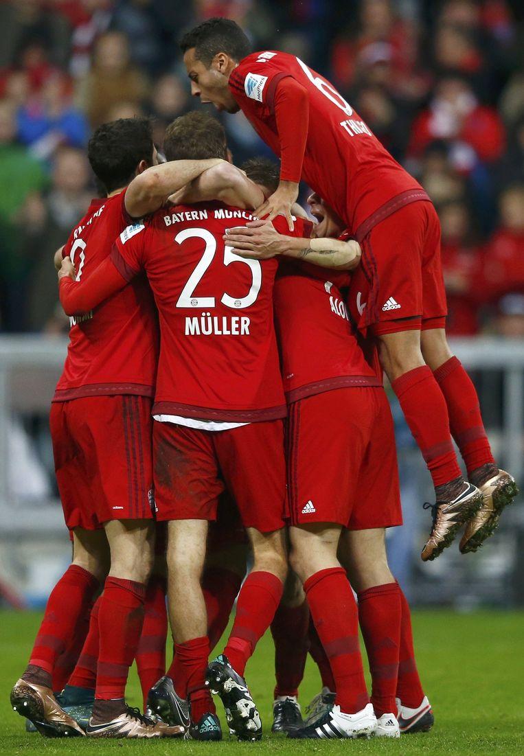 Spelers van Bayern München vieren feest. Beeld reuters