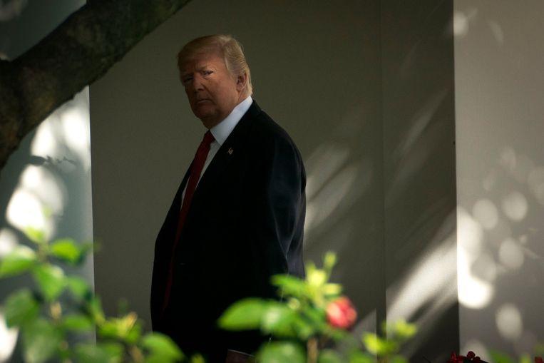 Trump beziet het hoogste ambt van het land  als een trofee die hij op elk moment en te allen prijze moet verdedigen. Beeld PREVIEWS NY TIMES
