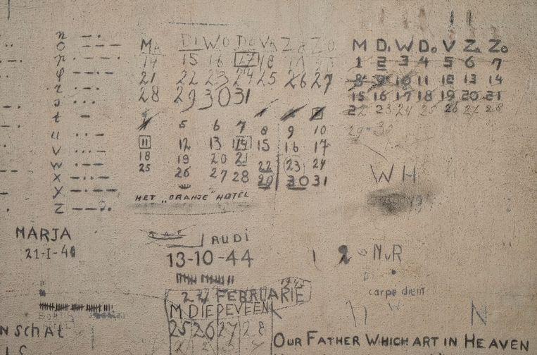 Inscripties op de muren in het Oranjehotel.  Beeld Raymond Rutting / de Volkskrant