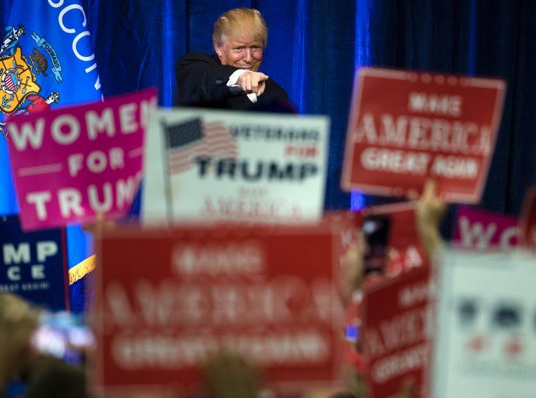 Donald Trump op een van zijn eerder verkiezingsbijeenkomsten. Beeld AP