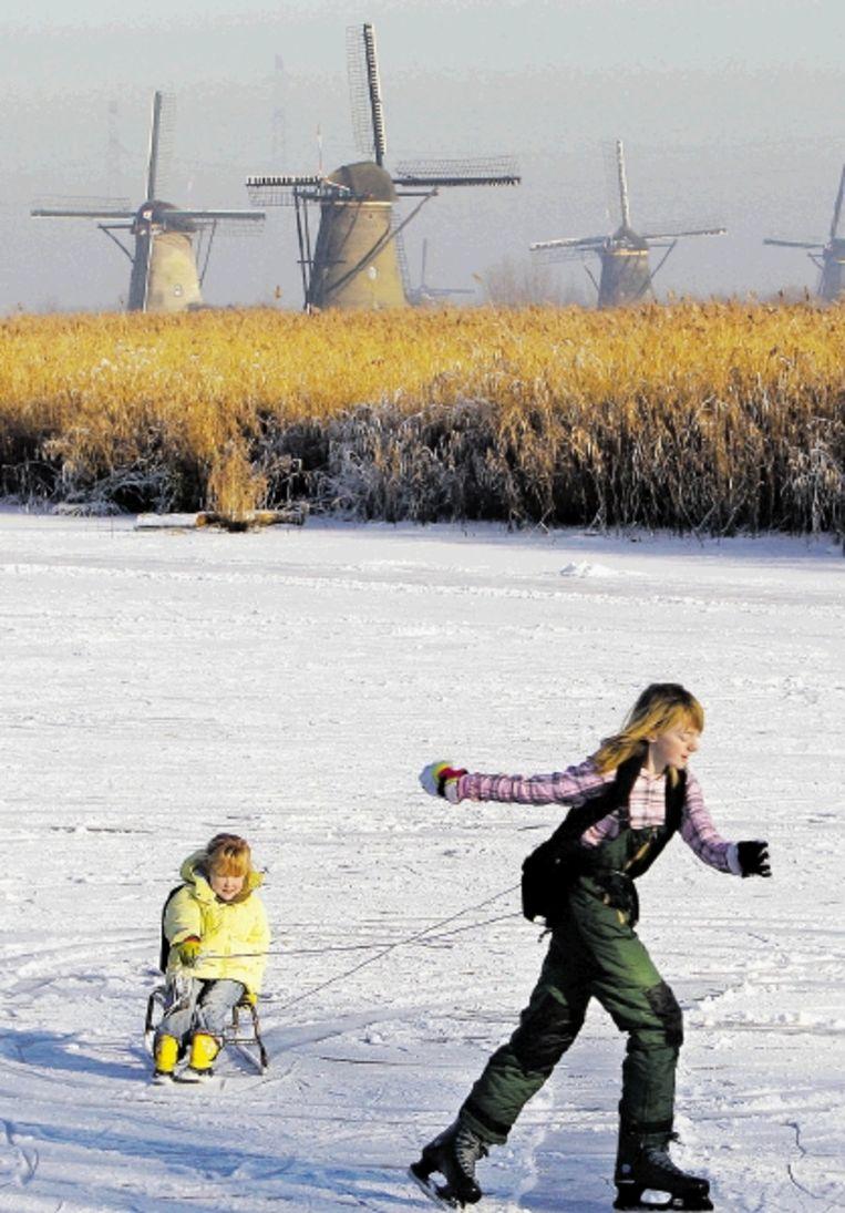 Schaatspret in Kinderdijk. Veel mensen noemen sport als een belangrijke vorm van ontspanning. (ANP) Beeld