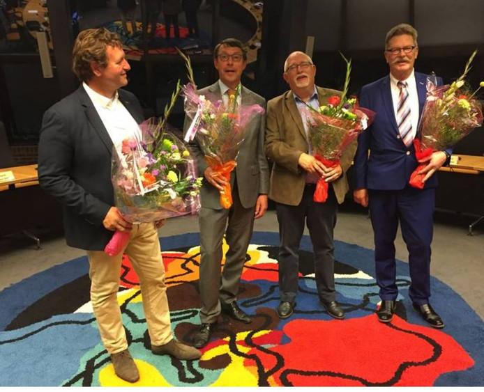 De herbenoemde wethouders Arjen Lagerweij, Harjo Pinkster, Wim Vrijhoef en Hans van der Sleen.