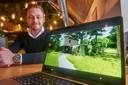 Charles Veerkamp toont op zijn laptop een van de toekomstige vakantiehuisjes op De Roompot in Schaijk