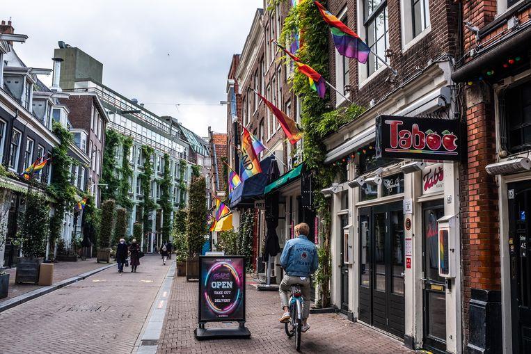 De Reguliersdwarsstraat in Amsterdam telt verschillende homobars. Beeld Joris Van Gennip