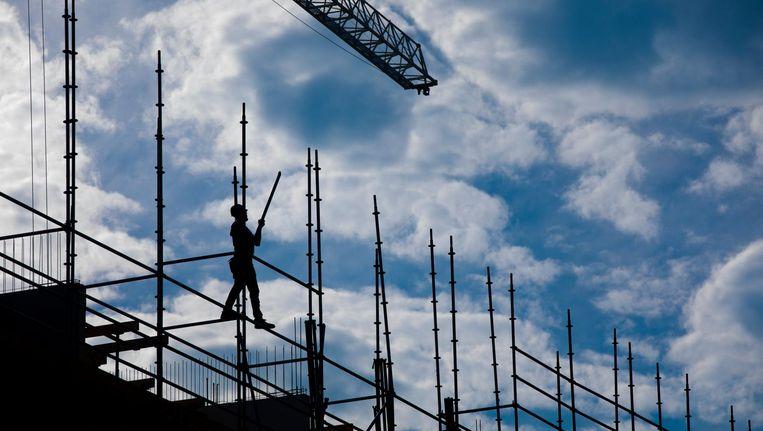 De bouw van nieuwe corporatiewoningen zal uiteindelijk zorgen voor meer woonruimte voor middeninkomens. Beeld anp