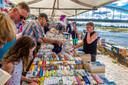 De handelaren op de boekenmarkt deden goede zaken.