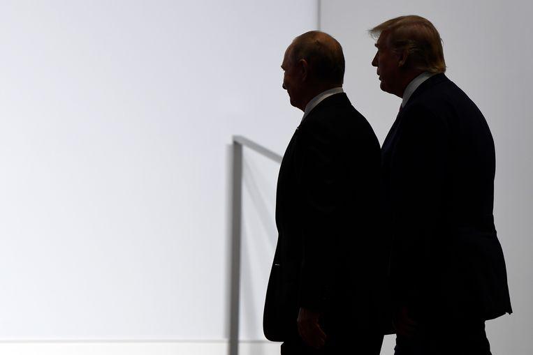 Russische president Vladimir Poetin en de Amerikaanse president Donald Trump. Beeld AP