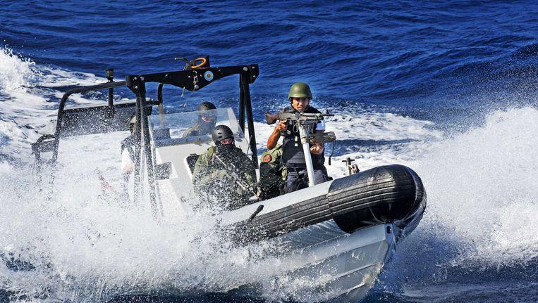 Mariniers in actie tijdens een antipiraterijmissie in 2009 Beeld ANP