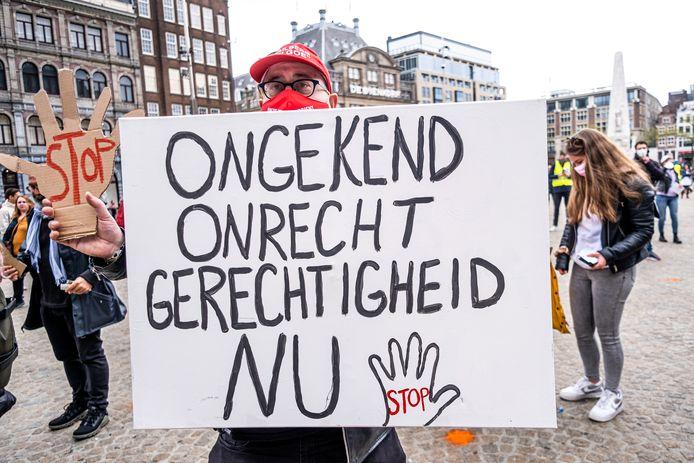 Beeld van een demonstratie eerder deze maand in Amsterdam van slachtoffers van de toeslagenaffaire.