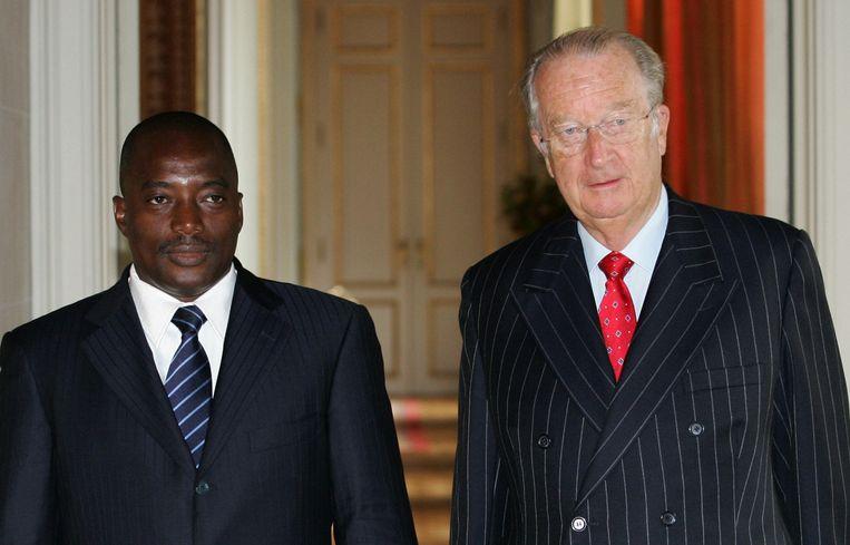 Joseph Kabila naast koning Albert II in 2007. Het staatsbezoek verliep in een ijzige sfeer. Beeld AFP