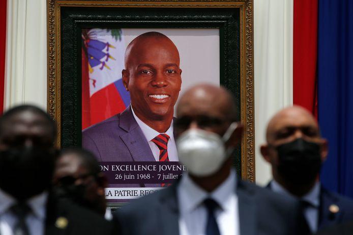 Een portret van Jovenel Moïse in Port-au-Prince.