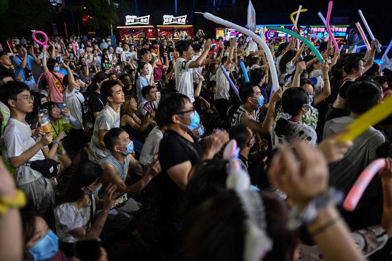 Bezoekers aan het muziekfestival in Wuhan. Beeld AFP