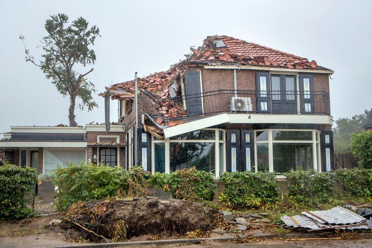 Een beschadigde woning in Leersum. Beeld Jörgen Caris