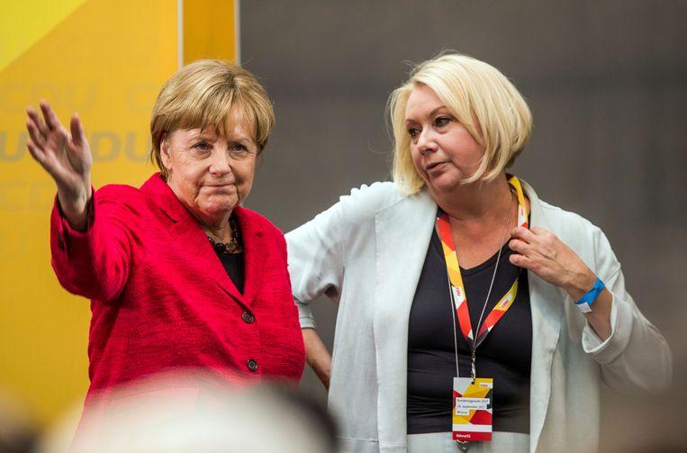 Angela Merkel en Karin Strenz in 2017. Beeld AP