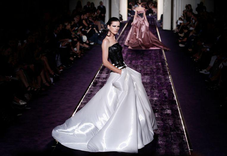 Stella Tennant voor Versace in 2014. Beeld EPA