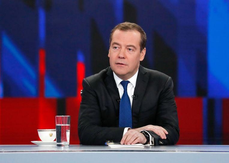 De Russische premier Dmitri Medvedev beantwoordt vragen van Russische journalisten op zijn jaarlijkse persconferentie. De beschuldigingen van corruptie door oppositieleider Aleksej Navalny kwamen niet ter sprake. Beeld AFP