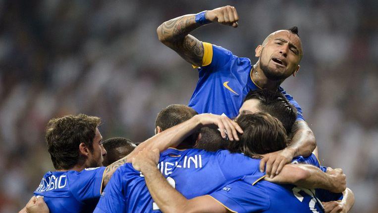 Juventus-speler Alvaro Morata en zijn teamgenoten vieren de overwinning. Beeld afp