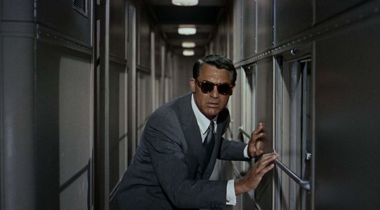 Cary Grant in North by Northwest van Alfred Hitchcock Beeld